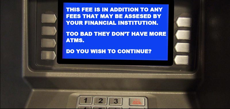ATM displaying a message about additional fees