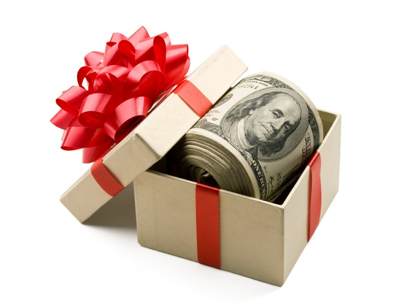 Roll of $100 bills in a gift box