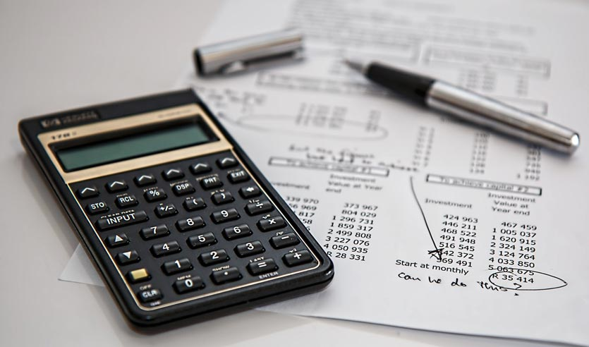 calculator and financial paperwork