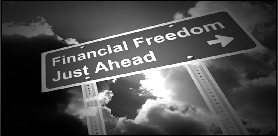 "a road sign that says ""financial freedom just ahead"""